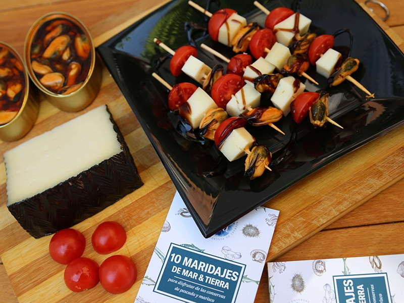 ESCABECHE MUSSELS SKEWER WITH MANCHEGO CHEESE AND CHERRYS